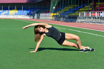 Girl doing a workout at the stadium