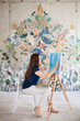 Artist painting picture on canvas