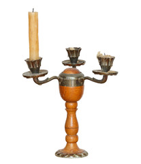 triple candlesholder with one candle isolated