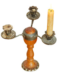 triple candlesholder with one lighted candle