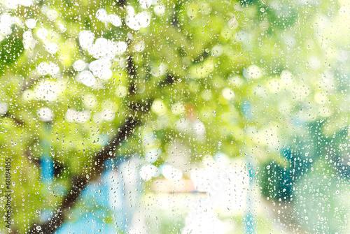 Leinwandbild Motiv home window with raindrops after summer rain