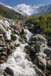 stream from melting glacier in Graian Alps - 68895256