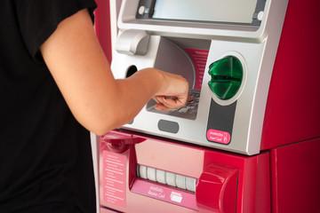 pressing ATM machine