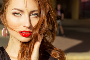 sexy girl with red hair with big red lips with makeup