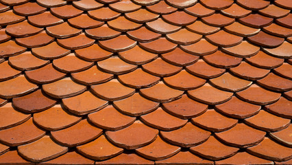 Thai temple roof, orange tile background