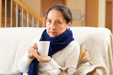 unwell woman in blue scarf