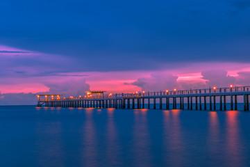 Landscape of Wooded bridge in the port between sunrise