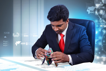 Business man creating model with cards