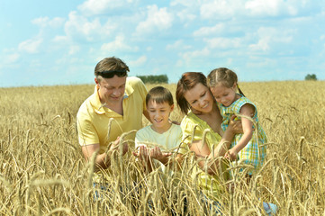 Happy family in field