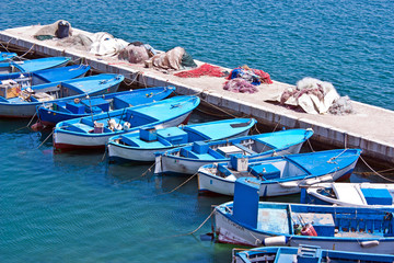 old rowboats docked at the pier - Puglia - Italy