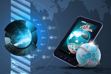 Earth globe close in chain   with tablet