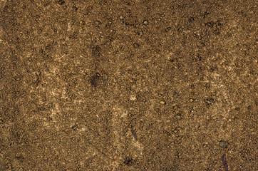Detailaufnahme einer Leinwand mit Acrylfarbe und Sand