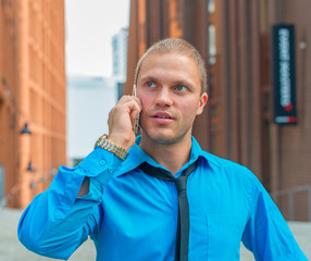 Businessman talking on the mobile phone outdoors.