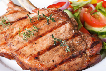 Grilled pork macro and salad with fresh vegetables