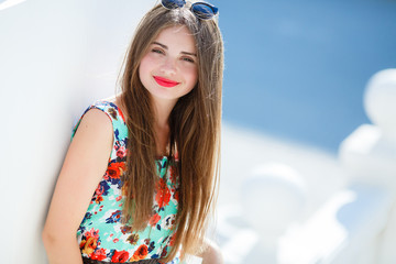 Portrait Of Young Smiling Beautiful Woman outdoors.