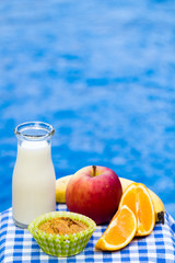 Healthy snack with muffin, fruit and fresh milk