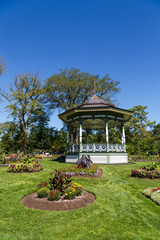 Ornate Gazebo in Green Garden Under Blue Sky
