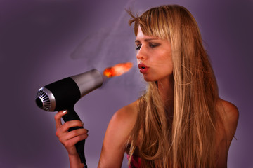 Woman surprised with hairdryer fire