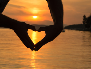 Siilhouette of hands in heart shape