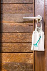 Please clean room sign hang on door knob.