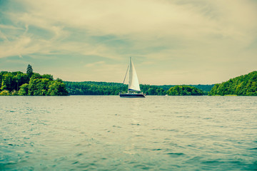 Boat with sail on a lake