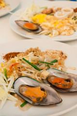 Seafood pad Thai dish of stir fried rice noodles