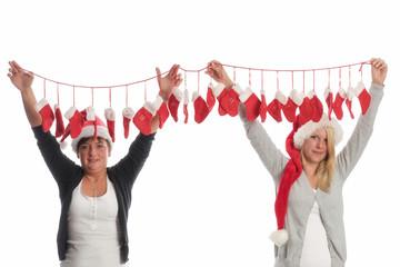 Nikolausmädchen halten Adventskalender
