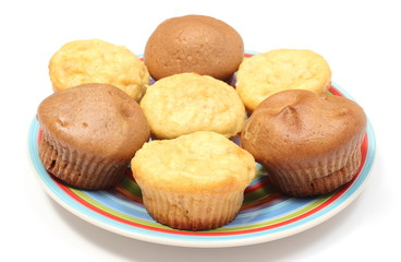Fresh baked apple and coffee muffins on colorful plate