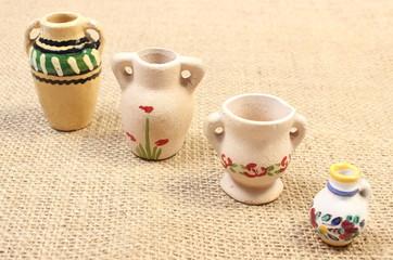 Decorative ceramic vases on jute canvas