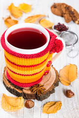 Flavored fruit tea in a knitted cover