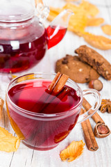 Fruit tea with cookies on wooden background