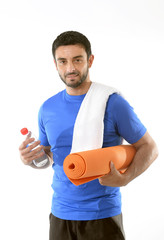 happy sport man posing with water and mat for fitness center