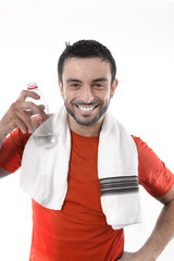 happy sport man posing with water and towel for fitness center