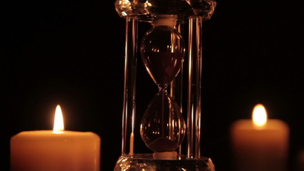 Hourglass and candle