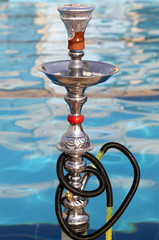 Hookah ‒ also known as a waterpipe, narghile,arghila  or shisha