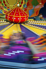 colorful carousel in motion in Theme Park