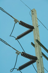 ceramics insulator with eletric line on pole