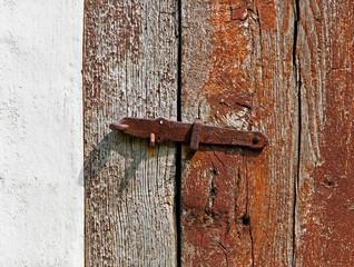 iron latch on a wooden door