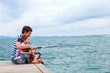 Father and son fishing together - 68912466