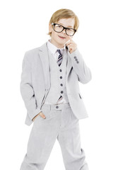 Child boy in glasses and suit, isolated over white background