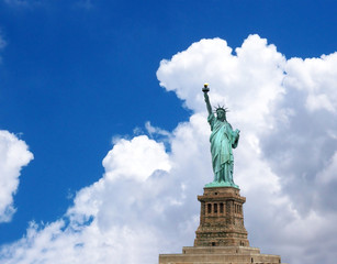 The statue of liberty in clouds sky background.