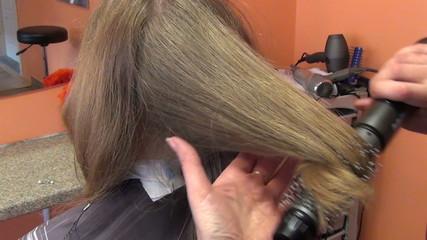 customer girl head closeup and hairdresser make hair dress