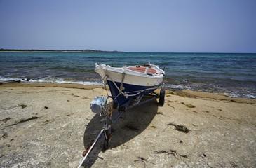 Italy, Sicily, Sampieri, wooden fishing boat ashore