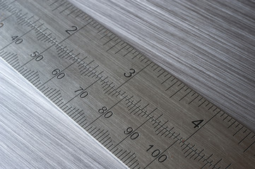 metal ruler on brushed metal background
