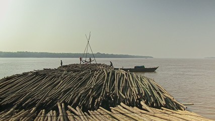 The convoy  of bamboo stop for on the mekong river
