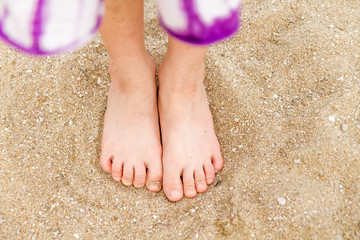 Child's bare feet in sand