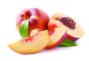 Ripe peach with leaf.