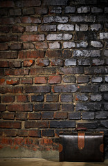 retro bag on brick wall background