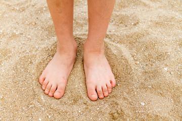 Child's bare feet in sand