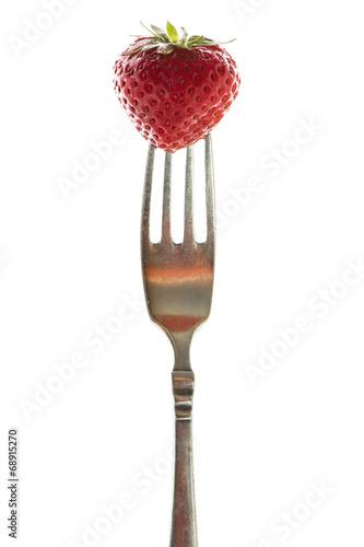 canvas print picture Rote Erdbeer auf einer Gabel